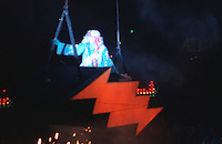 Bill Graham as Father Time Soaring Toward the Stage to the Grateful Dead on New Years Eve at the Stroke of Midnight. The Dead in Concert at the San Francisco Civic Auditorium, 31 December 1984 into 1 January 1985. Just as the Third Set Begins. Shot on Color Negative Film, Kodak CM135-36.