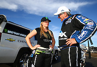 Feb 28, 2016; Chandler, AZ, USA; NHRA top fuel driver Brittany Force (left) reacts as she is consoled by her father John Force after losing in the final round of the Carquest Nationals at Wild Horse Pass Motorsports Park. Mandatory Credit: Mark J. Rebilas-