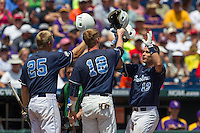North Carolina catcher Brian Holberton (10) is greeted at the plate by teammates Colin Moran (18) and Cody Stubbs (25) after he hit a 3 run home run in the first inning against the Louisiana State Tigers during Game 7 of the 2013 Men's College World Series on June 18, 2013 at TD Ameritrade Park in Omaha, Nebraska. The Tar Heels defeated the Tigers 4-2, eliminating LSU from the tournament. (Andrew Woolley/Four Seam Images)