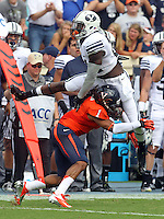 Brigham Young running back Jamaal Williams (21) attempts to leap over Virginia cornerback Demetrious Nicholson (1) during the first half of the game in Charlottesville, Va. Virginia defeated Brigham Young 19-16. Photo/Andrew Shurtleff