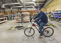 NWA Democrat-Gazette/FLIP PUTTHOFF <br /> PEDAL IT FORWARD<br /> David Tovey, president of Pedal It Forward, a nonprofit bicycle repair and distribution group, test rides a bike on Saturday Jan. 12 2019 at their shop in Rogers. The group repairs and distributes donated bicycles to anyone who needs a bike. Bikes are provided through organizations such as veterans groups and area schools. Bikes are free, but recipients are encouraged to pay what they can. About 20 volunteers repair bikes at the Pedal It Forward locations in Rogers and Bentonville. The group seeks more volunteers and more gently used bicycles, Tovey said. Bike repair skills aren't required for volunteers. Contact Pedal It Forward at bikes.pedal4ward@gmail.com, 616-915-5784 or see the group's Facebook page.
