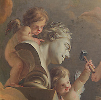 Putti sculpting a bust, detail from the painting The Alliance of Painting and Sculpture, by Charles-Michel-Ange Challe, 1717-78, from the Salon of 1753, on the ceiling of the Antechamber of the former theatre, known as Louis VI's small drawing room, Chateau de Fontainebleau, France. The Palace of Fontainebleau is one of the largest French royal palaces and was begun in the early 16th century for Francois I. It was listed as a UNESCO World Heritage Site in 1981. Picture by Manuel Cohen