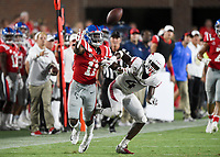 NWA Democrat-Gazette/CHARLIE KAIJO Ole Miss wide receiver Dontario Drummond (11) misses a pass as Arkansas Razorbacks defensive back Jarques McClellion (4) covers during the second half of a football game, Saturday, September 7, 2019 at Vaught-Hemingway Stadium in Oxford, Miss.