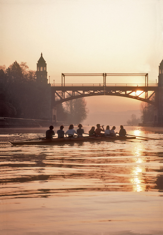 Seattle: women rowers in eight oared racing shell rest in the Montlake Cut at sunrise, Lake Washington Rowing Club, released,