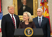 United States Secretary of Homeland Security (DHS) Kirstjen Nielsen, center, makes welcoming remarks at a naturalization ceremony hosted by US President Donald J. Trump in the Oval Office of the White House in Washington, DC on Saturday, January 19, 2019.  Looking on are United States President Donald J. Trump, left, and US Vice President Mike Pence, right.<br /> Credit: Ron Sachs / Pool via CNP