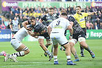 Rhys Webb of Ospreys is tackled by Paul Jedrasiak of Clermont during the Champions Cup Round 1 match between Ospreys and Clermont at The Liberty Stadium, Swansea, Wales, UK. Sunday 15 October 2017