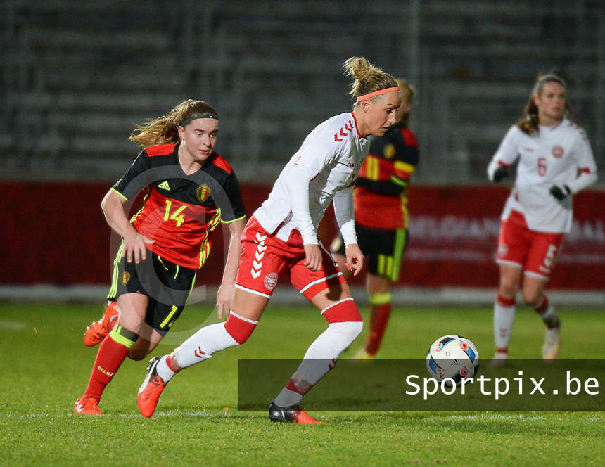 20161128 - TUBIZE ,  BELGIUM : Belgian Davinia Vanmechelen (L) and Danish Sanne Troelsgaard (R) pictured during the female soccer game between the Belgian Red Flames and Denmark , a friendly game before the European Championship in The Netherlands 2017  , Monday 28 th November 2016 at Stade Leburton in Tubize , Belgium. PHOTO SPORTPIX.BE | DIRK VUYLSTEKE