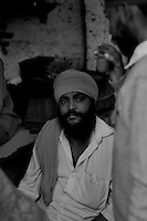 Atma Singh, 41 is one of those few lucky Sikh men, a teenager then, who could escape death. Two hundred Sikh families from Mongal Puri fought against the mob that attacked them on 1st November 1984. He said that if they did not fight together he would have also been killed like others. Tilak Vihar in New Delhi is called the widow colony. Widows and children of the Sikhs who were killed in 1984 Sikh Genocide live here. Four thousand Sikhs were killed in 72 hours in Delhi alone but no body till date has been punished for such an inhuman crime. Illiteracy, drug addiction, child labour and immense poverty characterize the area. Twenty five years ago all the male family members above the age of 15 were killed and burnt, leaving their uneducated widows and children behind to suffer, even after 25 years. The present generation is jobless, steeped in alcoholism and have lost their directions in life. November 2009. New Delhi, India, Arindam Mukherjee