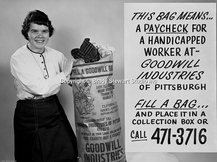 Pittsburgh PA:  View of new advertisement for Donating to the Goodwill Industries of Pittsburgh - 1966.<br /> In 1966, Goodwill Industries was part of the United Fund Community Chest Agency which eventually became the United Way of Allegheny County in 1974. Goodwill Industries provides a broad array of employment-related education and workforce development programs and services for people with physical and intellectual disabilities and other barriers to employment.