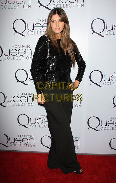 BRITTNY GASTINEAU.'Queen Latifah' Birthday Party_Inside held at SIR, Hollywood, California, USA..March 28th, 2009.full length black trousers sequins sequined top hand on hip.CAP/ADM/KB.©Kevan Brooks/AdMedia/Capital Pictures.