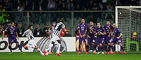 Calcio, ritorno degli ottavi di finale di Europa League: Fiorentina vs Juventus. Firenze, stadio Artemio Franchi, 20 marzo 2014. <br /> Juventus midfielder Andrea Pirlo, second from left, scores the winning goal on a free kick during the Europa League round of 16 second leg football match between Fiorentina and Juventus at Florence's Artemio Franchi stadium, 20 March 2014. Juventus won 1-0 to advance to the quarter-finals.<br /> UPDATE IMAGES PRESS/Isabella Bonotto