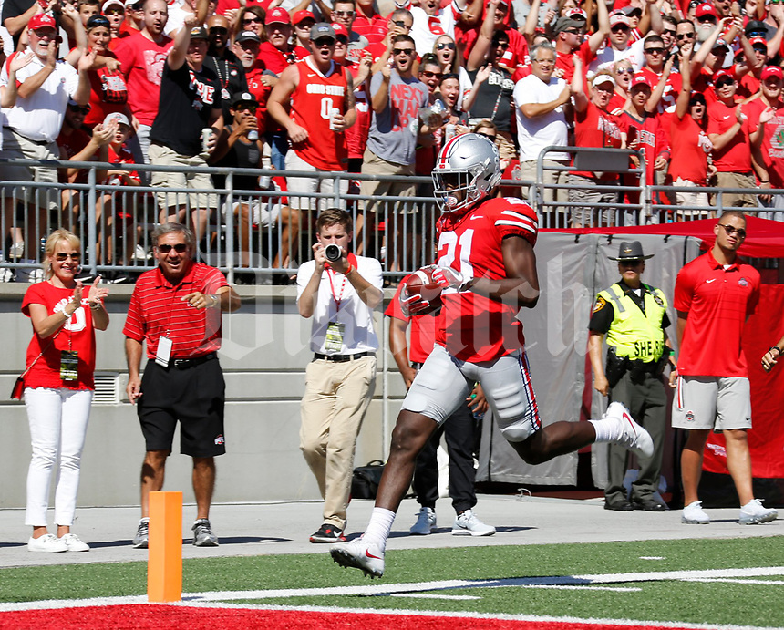 Ohio State Buckeyes wide receiver Parris Campbell (21) jogs for a touchdown during the first quarter of Saturday's NCAA Division I football game against the UNLV Rebels at Ohio Stadium in Columbus on September 23, 2017. [Barbara J. Perenic/Dispatch]