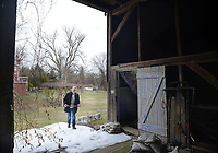 Will Hammerstein walks into the barn on the property Friday March 24, 2017 at Highland Farm in Doylestown, Pennsylvania. Hammerstein is in the process of raising money to restore the old brand create a Hammerstein museum dedicated to his grandfather, Oscar Hammerstein, writer of the broadway musicals, Sound of Music, King and I, Oklahoma and Carousel to name a few. (WILLIAM THOMAS CAIN / For The Philadelphia Inquirer)