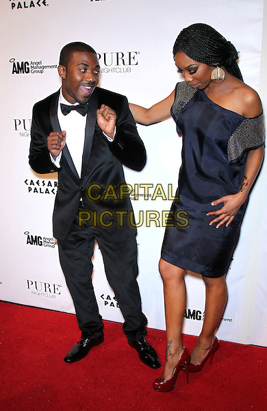 RAY J (William Raymond Norwood Jr.) & BRANDY (Brandy Norwood).Ray J celebrates his 30th birthday at Pure Nightclub inside Caesar's Palace Resort Hotel and Casino, Las Vegas, Nevada, USA, 15th January 2011..full length black bow tie tux tuxedo navy blue one off the shoulder dress silk satin family brother sister arm around siblings hands funny looking down .CAP/ADM/MJT.© MJT/AdMedia/Capital Pictures.