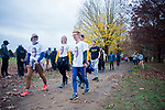 LOUISVILLE, KY - NOVEMBER 18: Spectators walk to the start line wearing shirts depicting Bryce Miller #668 of the University of Missouri - Kansas City during the Division I Men's Cross Country Championship is held at E.P. Tom Sawyer Park on November 18, 2017 in Louisville, Kentucky. (Photo by Tim Nwachukwu/NCAA Photos via Getty Images)