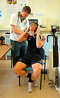 Pictured: Shaun MacDonald gets a breathing measuring mask on with the help of Matthew Evans, student in Sports Science.<br />