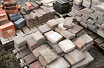 Clay bricks piled up in builder's yard, UK