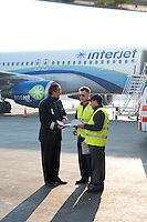 Captain Mario Escalera Cardenas, Philippe Housset and Thierry Kocher discuss recent maintenance work performed on Interjet planes. Power Jet maintenance to Interjet planes at the Mexico City airport.  Mexico DF, Mexico