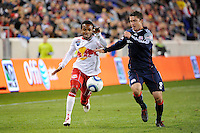 Dane Richards (19) of the New York Red Bulls is defended by Chris Tierney (8) of the New England Revolution. The New York Red Bulls defeated the New England Revolution 2-0 during a Major League Soccer (MLS) match at Red Bull Arena in Harrison, NJ, on October 21, 2010.