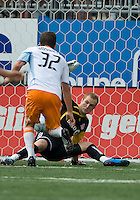 18 July 2009: Houston Dynamo defender Bobby Boswell #32 scores a goal on Toronto FC goalkeeper Stefan Frei #24 during a game between the Toronto FC and Houston Dynamo..The game ended in a 1-1 draw..