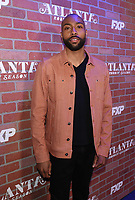 """LOS ANGELES - FEBRUARY 19: Jeremie Harris arrives at the red carpet event for FX's """"Atlanta Robbin' Season"""" at the Ace Theatre on February 19, 2018 in Los Angeles, California.(Photo by Frank Micelotta/FX/PictureGroup)"""