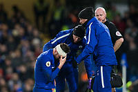 Chelsea's Olivier Giroud grimaces while getting treatment to a head injury <br /> <br /> Photographer Craig Mercer/CameraSport<br /> <br /> The Premier League - Chelsea v West Bromwich Albion - Monday 12th February 2018 - Stamford Bridge - London<br /> <br /> World Copyright &copy; 2018 CameraSport. All rights reserved. 43 Linden Ave. Countesthorpe. Leicester. England. LE8 5PG - Tel: +44 (0) 116 277 4147 - admin@camerasport.com - www.camerasport.com