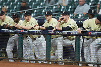 The Vanderbilt Commodores dugout looks on in the game against the Houston Cougars during game nine of the 2018 Shriners Hospitals for Children College Classic at Minute Maid Park on March 3, 2018 in Houston, Texas. The Commodores defeated the Cougars 9-4. (Brian Westerholt/Four Seam Images)