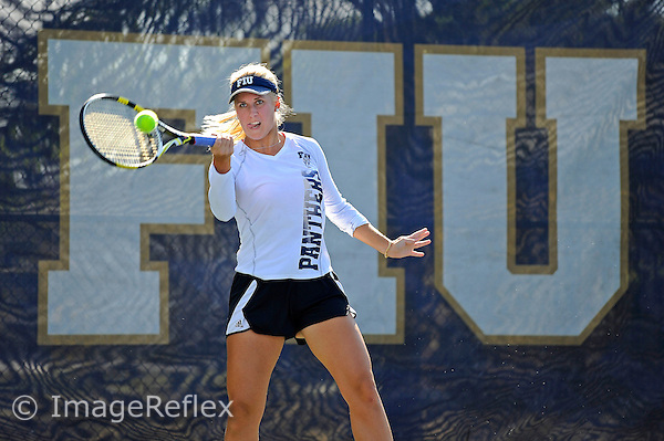 26 January 2013:  FIU's Giulietta Boha returns a shot during her doubles match as the Florida Gulf Coast University Eagles defeated the FIU Golden Panthers, 4-3, at University Park in Miami, Florida.