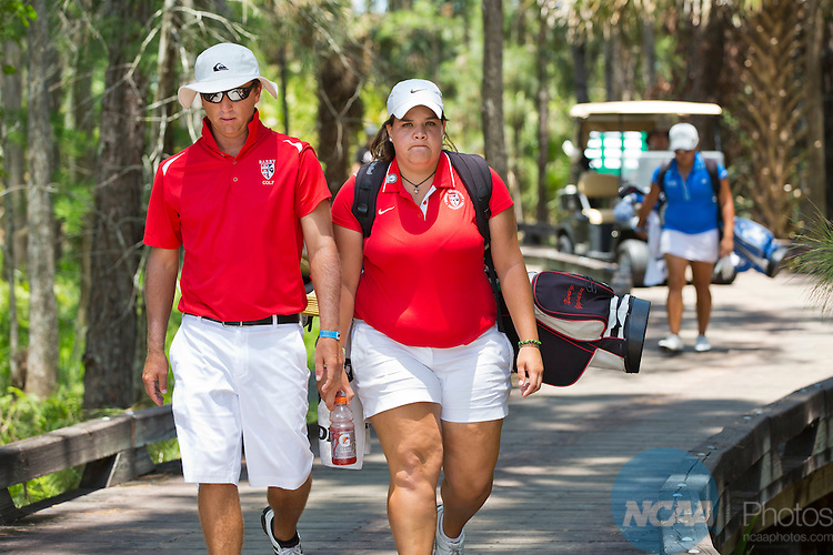 18 MAY 2013:  Nancy Vergara of Barry walks with her coach Shannon Sykora during the Division II Women's Golf Championship held at the LPGA International Golf Course in Daytona Beach, FL. Vergara won the singles title by a single stroke narrowly edging out Linnea Johansson of Nova Southern.  Lynn University shot a +17 to win the national teams title by 3 strokes.  Matt Marriott/NCAA Photos