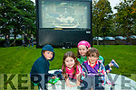 l-r Conor Meegan, Muireann Megan, Katie Teehan and Saoirse Meegan  enjoying the Open Air Film screening of  Shaun the Sheep  in Pearse Park part of Culture Night on Friday