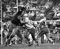 Raiders vs 49ers..John Brodie passing,Len Rohde blocking against Ben Davidson...(1969 photo/Ron Riesterer)