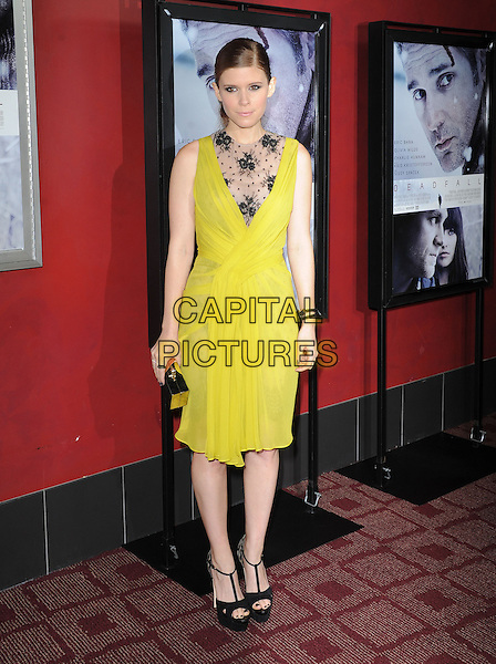 Kate Mara.at The Magnolia Pictures L.A. Premiere of 'Deadfall' held at The Arclight Theatre in Hollywood, California, USA,  November 29th 2012..full length chartreuse dress yellow lace sheer ruched black sleeveless  clutch bag sandals platform open toe ankle strap cut out                                                     .CAP/DVS.©Debbie VanStory/Capital Pictures.