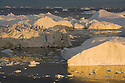 Large icebergs at midnight, end of June, mid summer night; Disko Bay, Greenland
