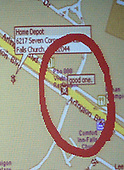 A map program is displayed on a screen during the trial of sniper suspect John Allen Muhammad in courtroom 10 at the Virginia Beach Circuit Court in Virginia Beach, Virginia on November 5, 2003.  The map program was found in the laptop found in the Chevrolet Caprice that Muhammad was arrested in. The circled area represents shooting site where a skull and crossbones has been inserted. <br /> Credit: Dave Ellis - Pool via CNP