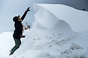 02/03/18<br /> <br /> Chloé Kirkpatrick inspects an eight foot high snow drift that closed a road in Sparrowpit near Buxton in the Derbyshire Peak District.<br />   <br /> All Rights Reserved F Stop Press Ltd. +44 (0)1335 344240 +44 (0)7765 242650  www.fstoppress.com