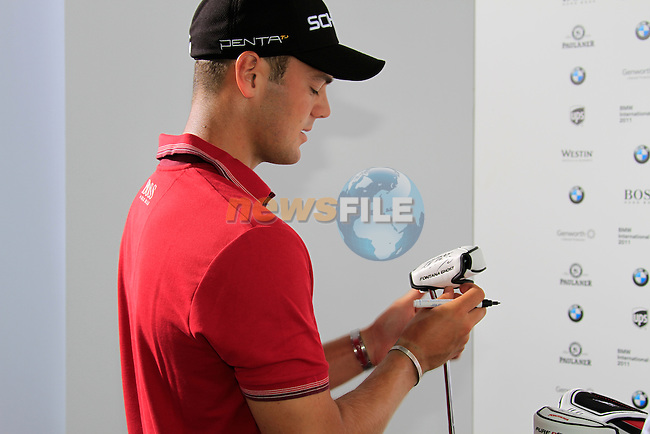Martin Kaymer (GER) signs clubs after finishing the Pro-Am Day of the BMW International Open at Golf Club Munchen Eichenried, Germany, 22nd June 2011 (Photo Eoin Clarke/www.golffile.ie)