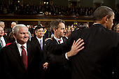 United States Secretary of the Timothy F. Geithner pats U.S. President Barack Obama on the back as he leaves the House Chamber at the conclusion of his State of the Union address, Wednesday, January 27, 2010. At left is U.S. Secretary of Defense Robert M. Gates..Mandatory Credit: Pete Souza - White House via CNP