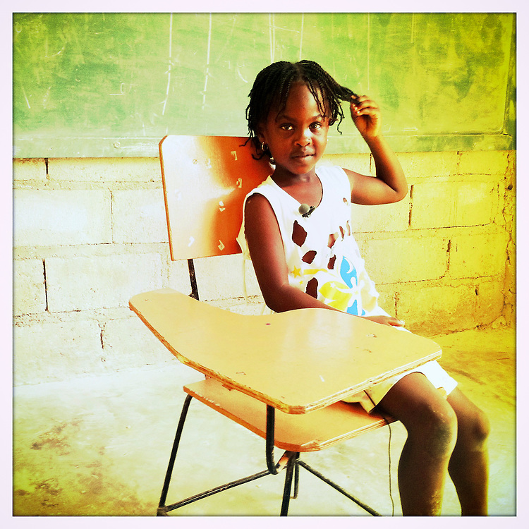 First grader, Jasmine, 7, at Camp Silow, a Plan-sponsored Child Friendly Space, in Jacmel, Haiti