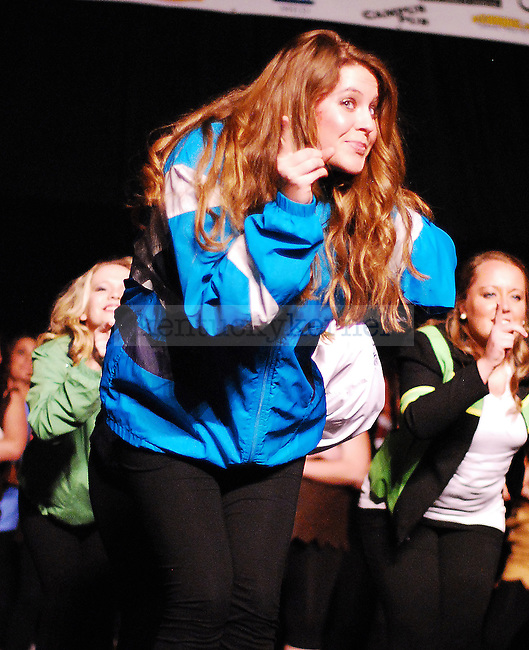 An Alpha Gamma Delta sister dances  in the 2011 Greek Sing event held at Memorial Coliseum in Lexington, Ky. on Feb. 5, 2011. Photo by Ryan Buckler | Staff