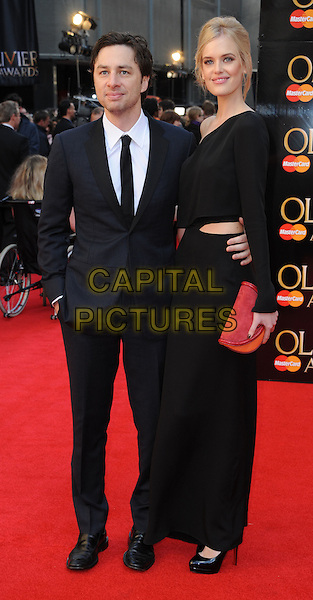 Zach Braff & Taylor Bagley.The Olivier Awards 2012, Royal Opera House, Covent Garden, London, England..April 15th, 2012.full length dress suit couple red clutch bag black .CAP/WIZ.© Wizard/Capital Pictures.