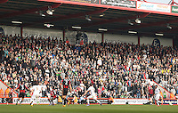 Swansea fans watch on during the Barclays Premier League match between AFC Bournemouth and Swansea City played at The Vitality Stadium, Bournemouth on March 11th 2016