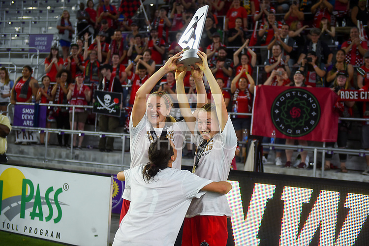 Orlando, FL - Saturday October 14, 2017: Lindsey Horan, Emily Sonnett and the Portland Thorns FC celebrate their National Women's Soccer League (NWSL) Championship win by defeating North Carolina Courage 1-0 during the NWSL Championship match between the North Carolina Courage and the Portland Thorns FC at Orlando City Stadium.