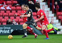 Lincoln City's Harry Anderson gets between Swindon Town's Matthew Taylor, left, and Dion Conroy<br /> <br /> Photographer Andrew Vaughan/CameraSport<br /> <br /> The EFL Sky Bet League Two - Swindon Town v Lincoln City - Saturday 12th January 2019 - County Ground - Swindon<br /> <br /> World Copyright &copy; 2019 CameraSport. All rights reserved. 43 Linden Ave. Countesthorpe. Leicester. England. LE8 5PG - Tel: +44 (0) 116 277 4147 - admin@camerasport.com - www.camerasport.com