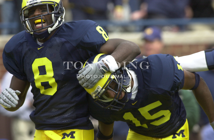 Michigan sophomores Jason Avant (8) and Steve Breaston (15) celebrate after Breaston scored a touchdown during the Wolverine's 56-14 victory over Illinois at Michigan Stadium on October 17, 2003 in Ann Arbor, Mich. (TONY DING/Daily)