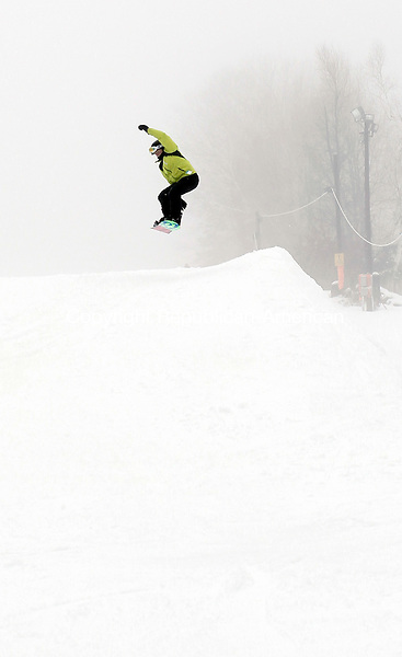 Woodbury, CT- 05 January 2015-010415CM06-  Andrew Manesis, 10, of Brookfield goes airborne while snowboarding at Woodbury Ski Area on Sunday.  Christopher Massa Republican-American