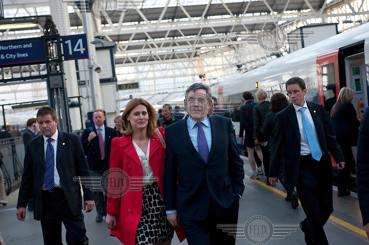 Prime Minister and Labour Party leader Gordon Brown and his wife Sarah arrive back in London after a day of campaigning.