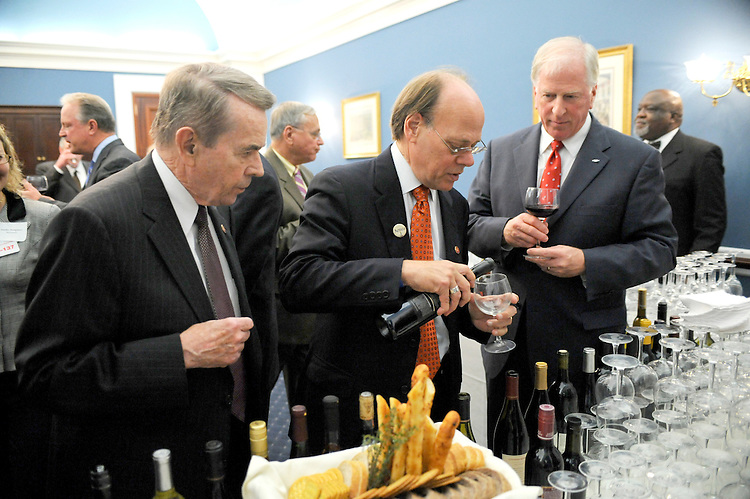 From left, Rep. Dale Kildee, D-Mich., Rep. Steven Cohen, D-Tenn., and Rep. Mike Thompson, D-Calif., pour wine at the bar during the Congressional Wine Causus' event to celebrate wine from all 50 states held in the U.S. Capitol building on Wednesday, Nov. 15, 2007.