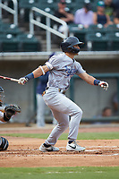 Mark Contreras (5) of the Pensacola Blue Wahoos follows through on his swing against the Birmingham Barons at Regions Field on July 7, 2019 in Birmingham, Alabama. The Barons defeated the Blue Wahoos 6-5 in 10 innings. (Brian Westerholt/Four Seam Images)