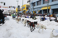 Saturday March 6 , 2010   Ross Adam leaves the start line      during the ceremonial start of the 2010 Iditarod in Anchorage , Alaska