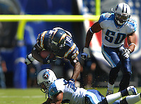 Sept. 17, 2006; San Diego, CA, USA; San Diego Chargers running back (21) LaDainian Tomlinson is upended by a Tennessee Titans defender at Qualcomm Stadium in San Diego, CA. Mandatory Credit: Mark J. Rebilas